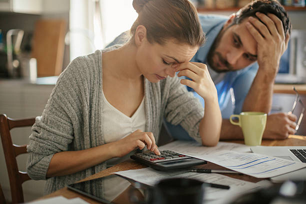Photo of a couple going through  financials problems